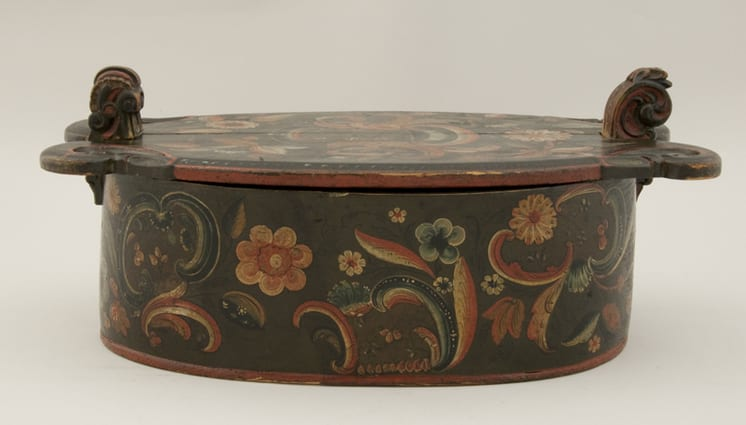 Bentwood box with pegged base - cover held by decoratively carved wood extensions - Rosemaling