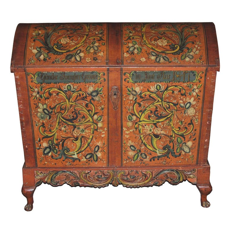 Trunk has dovetailed corner construction with iron reinforcements at the corners and diamond shape escutcheon - Rosemaling