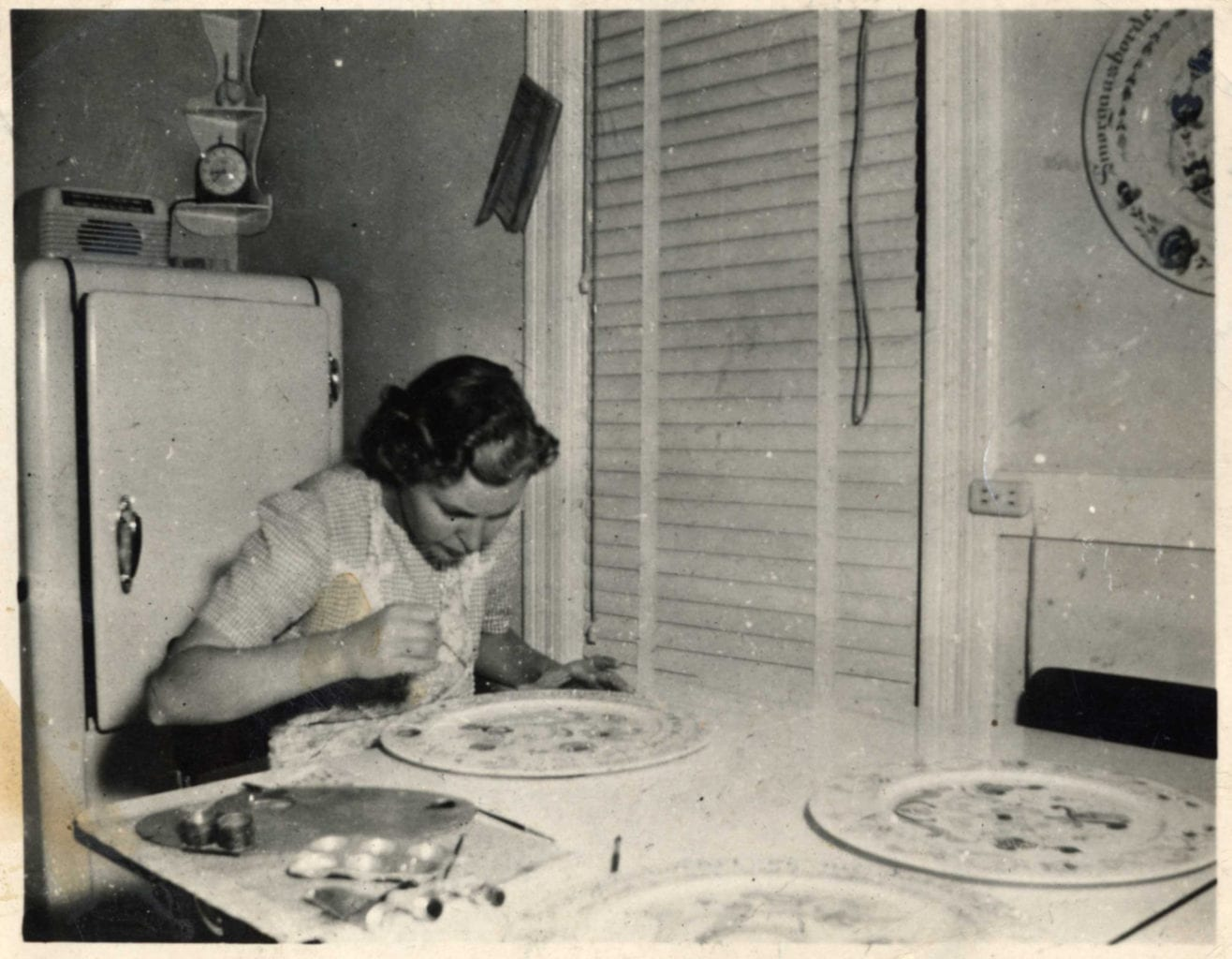 possibly Louise Lysne rosemaling a plate