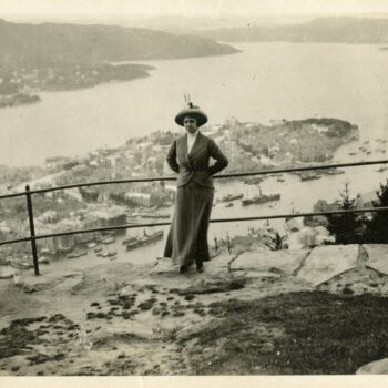 A woman poses at Fløibanen in Bergen. A beautiful view of Bergen.