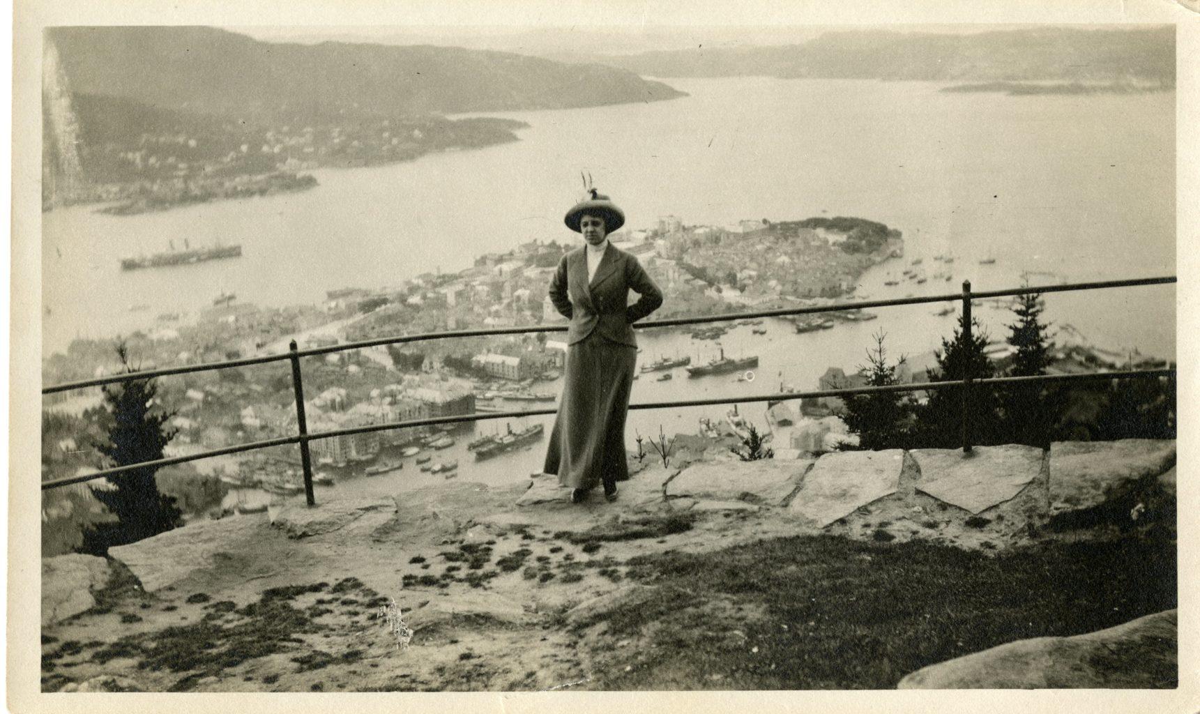 A woman poses at Fløibanen in Bergen. A beautiful view of Bergen.