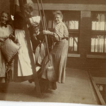 Four women pose for a photograph outside of a building.
