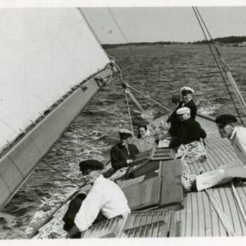 Six people on a sailboat.