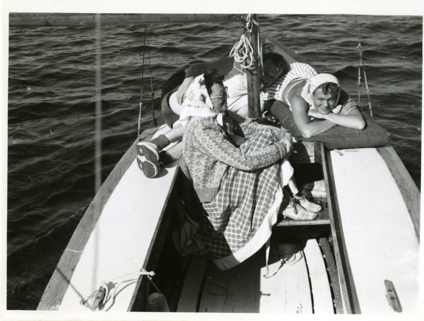 Three people on a boat.
