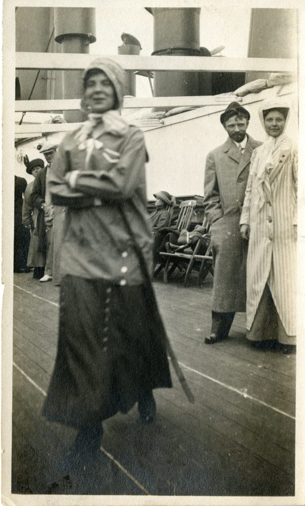 Man and woman pose for photo, while woman walks towards camera.