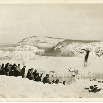 People gather to watch a skier jump.