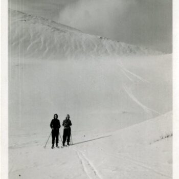 Two women skiing.