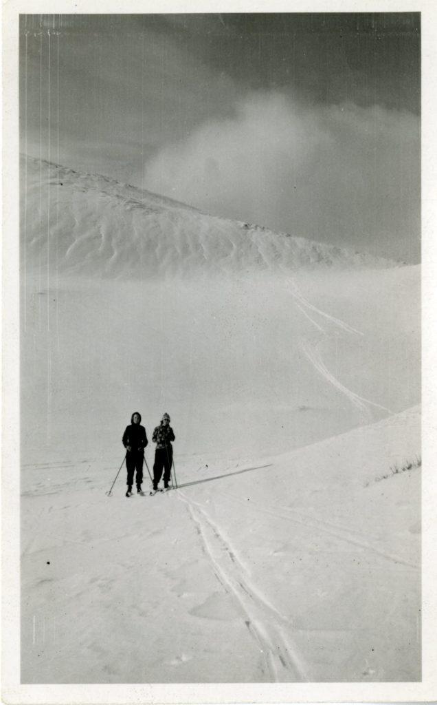 Two women skiing.
