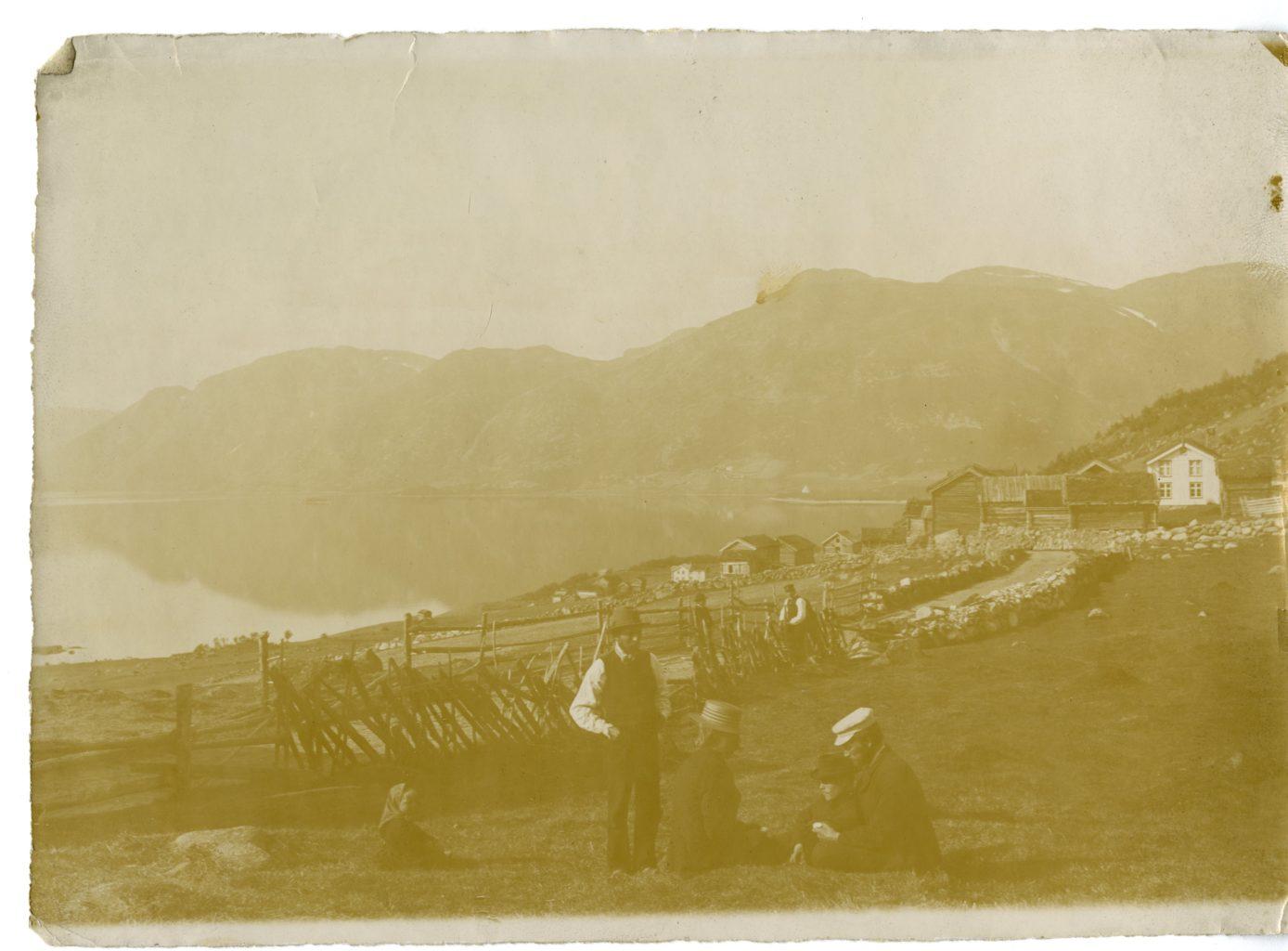 People rest alongside road near Lake Totak.