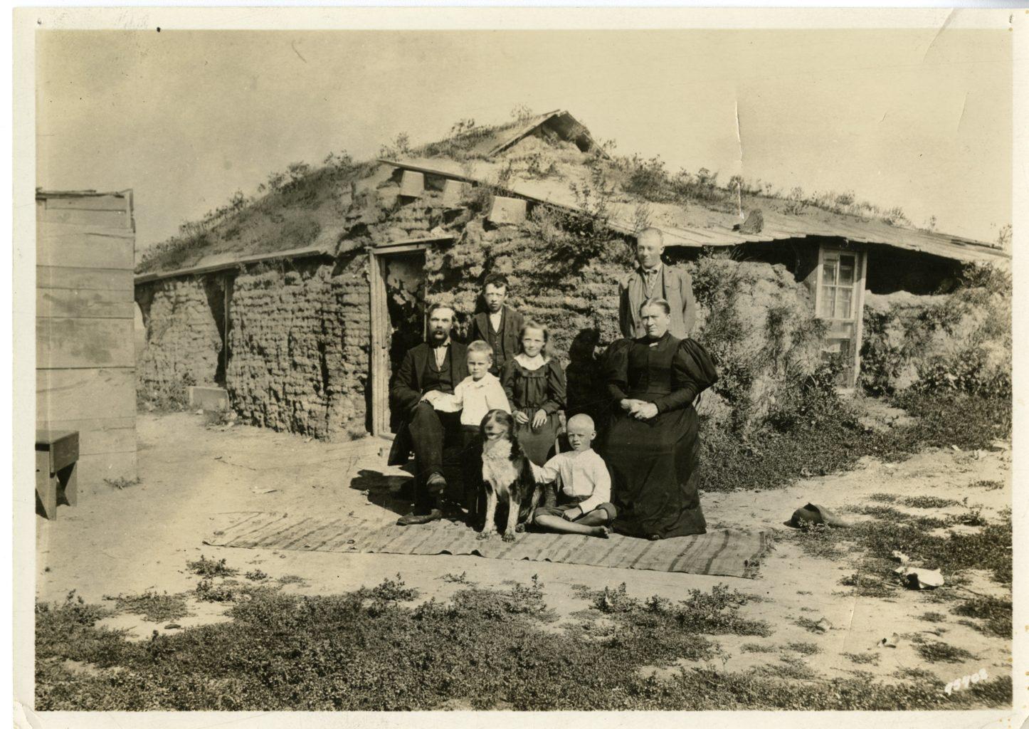 Family photo outside of house.