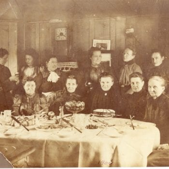 Group of women part of Ladies Aid for Big Canoe Church, sit around a table