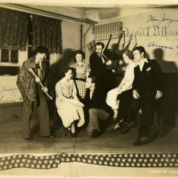 Seven individuals dressed up to act.