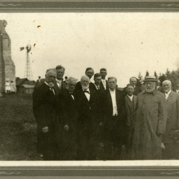 Group of men pose for photo with Bishop Brockman at Washington Prairie.