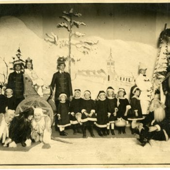 Group children and adults doing a play.