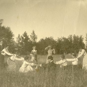 Eleven people play in a field.