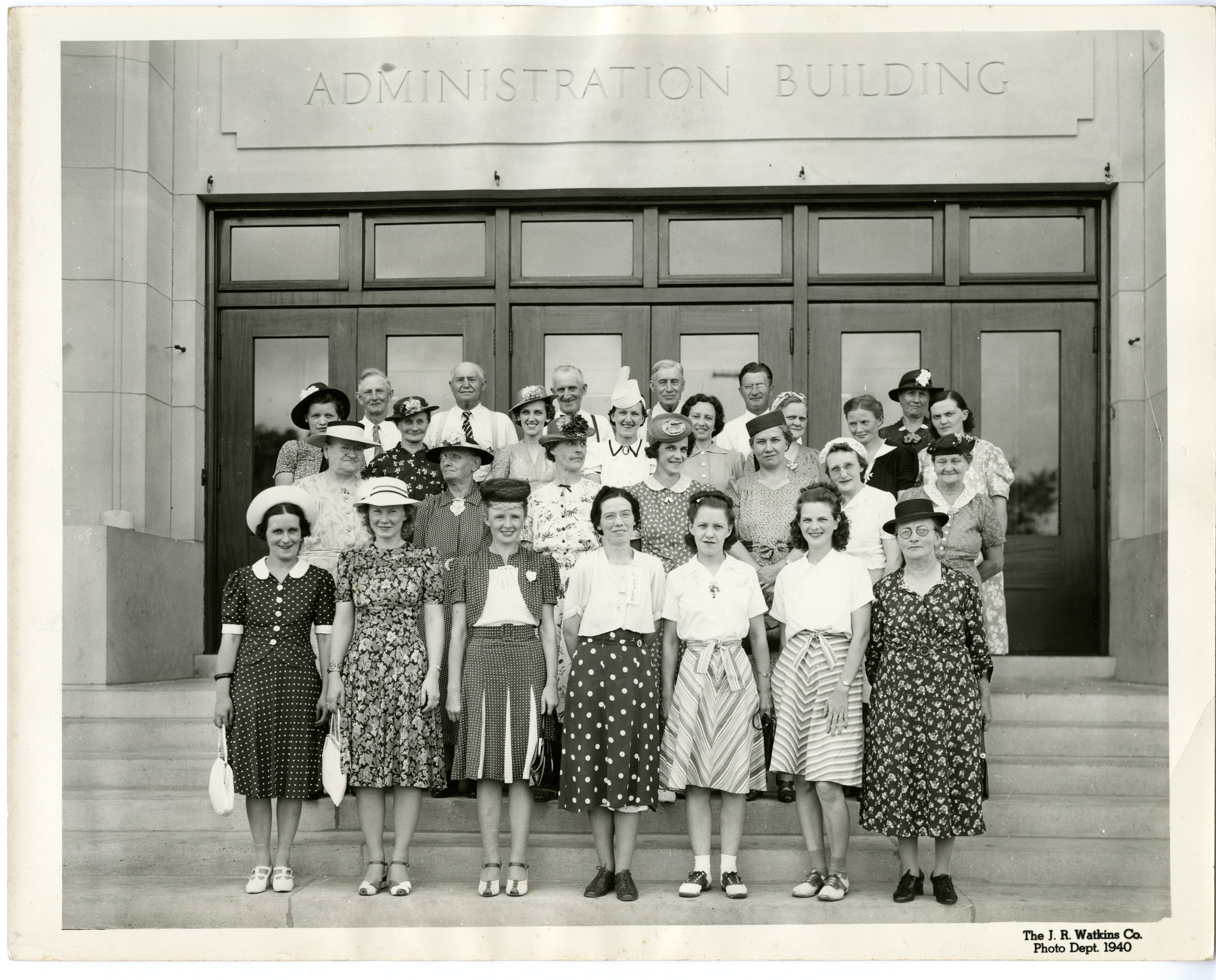 Group of women and five men outside of Administration Building.