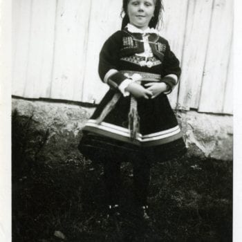Six year old girl poses for photo in national dress.