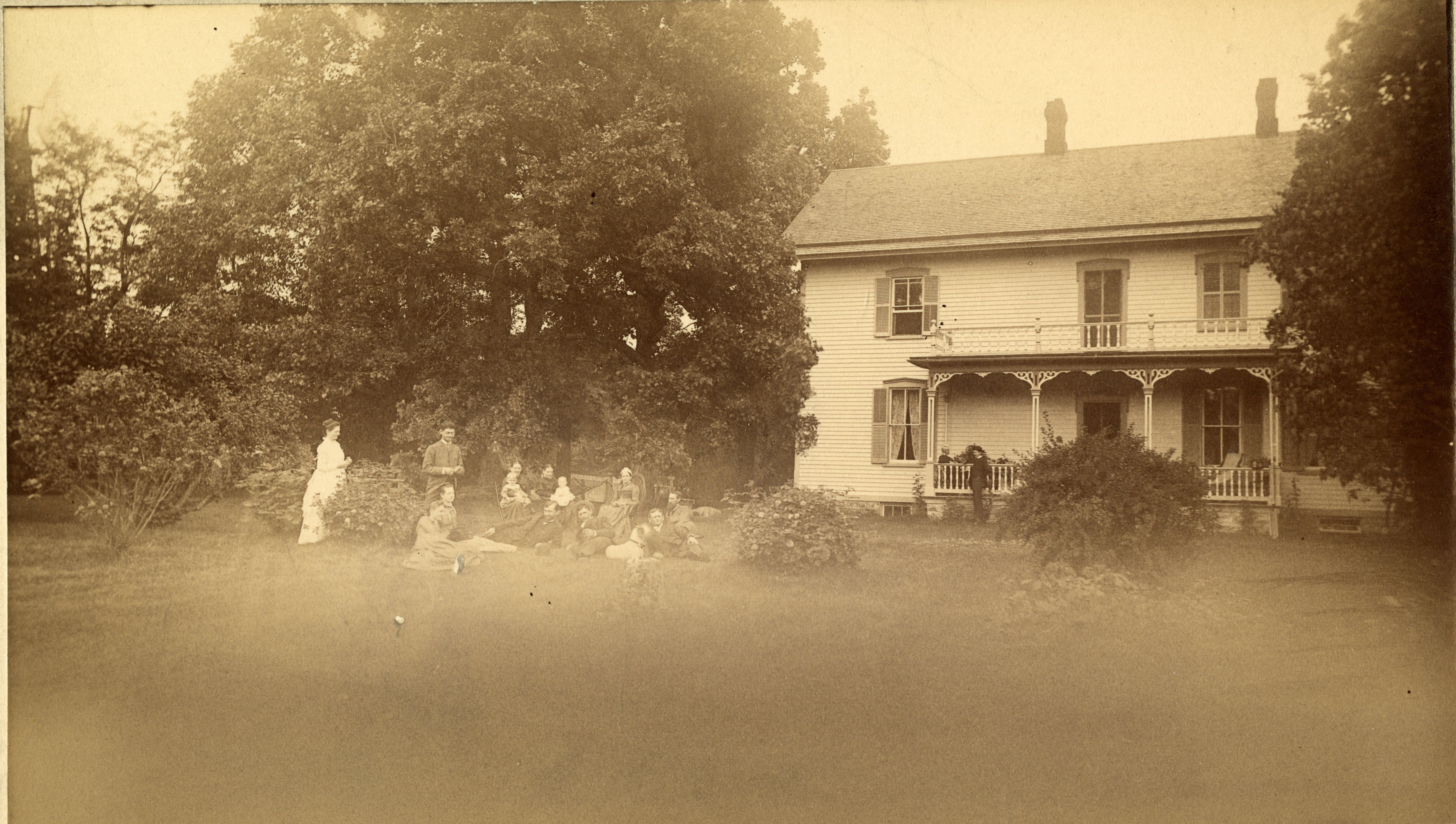 Group of fifteen gather outside the Koren parsonage.