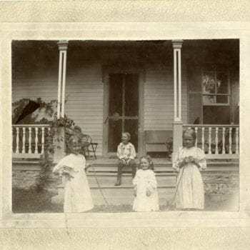 Elsa Marie, Esther, two more children play jump rope outside of Koren House at Washington Prairie Parsonage.