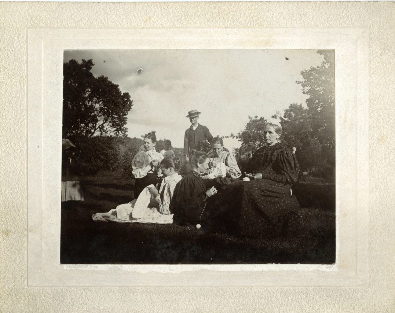 About ten people sit together at the Washington Prairie Parsonage