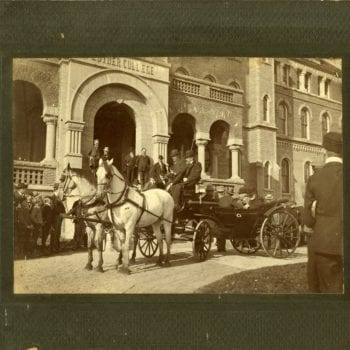 Men outside of Luther's Main Building with horse and buggy.