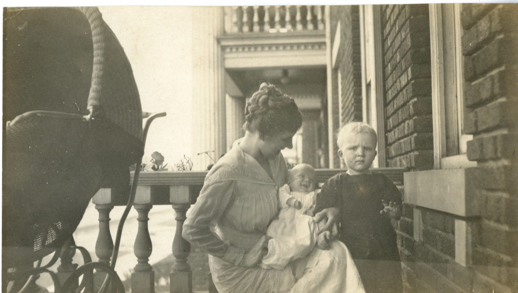 Woman and two small children pose for photo.