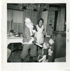 Two children met Santa.
