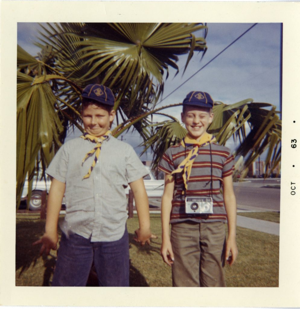 Two boys pose for a silly photo.