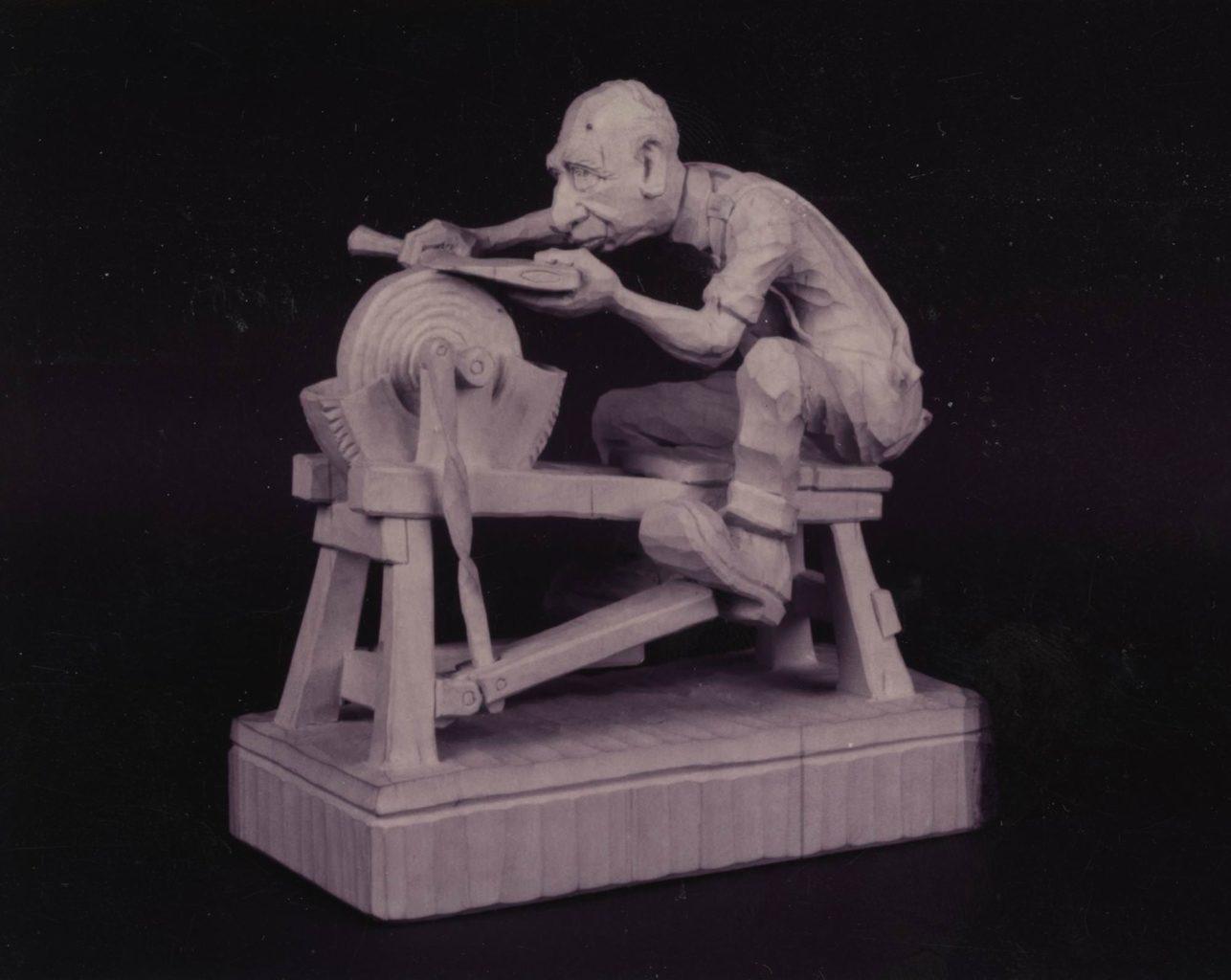 """Man at Grindstone"" figure © 1989 Marvin Kaisersatt ""Man at Grindstone"" figure © 1989 Marvin Kaisersatt"