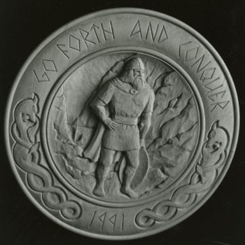 """Go Forth and Conquer"" relief-carving plate © 1991 Becky Lusk ""Go Forth and Conquer"" relief-carving plate © 1991 Becky Lusk"